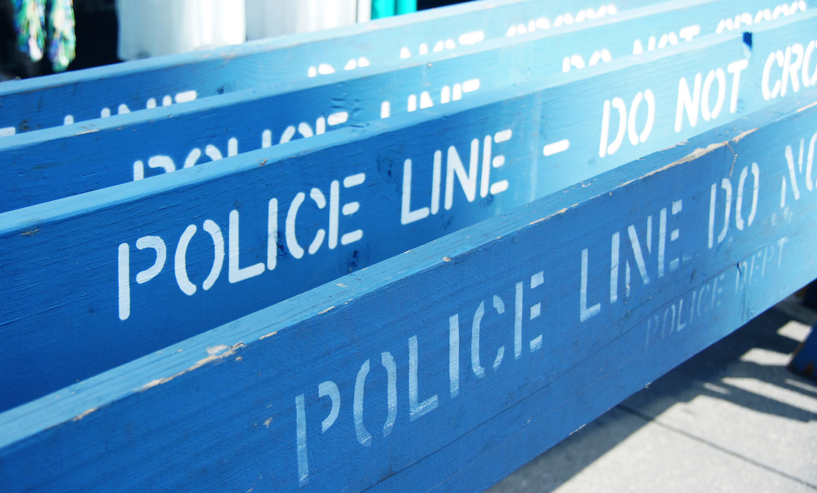"Four blue ""Police Line"" barricades"