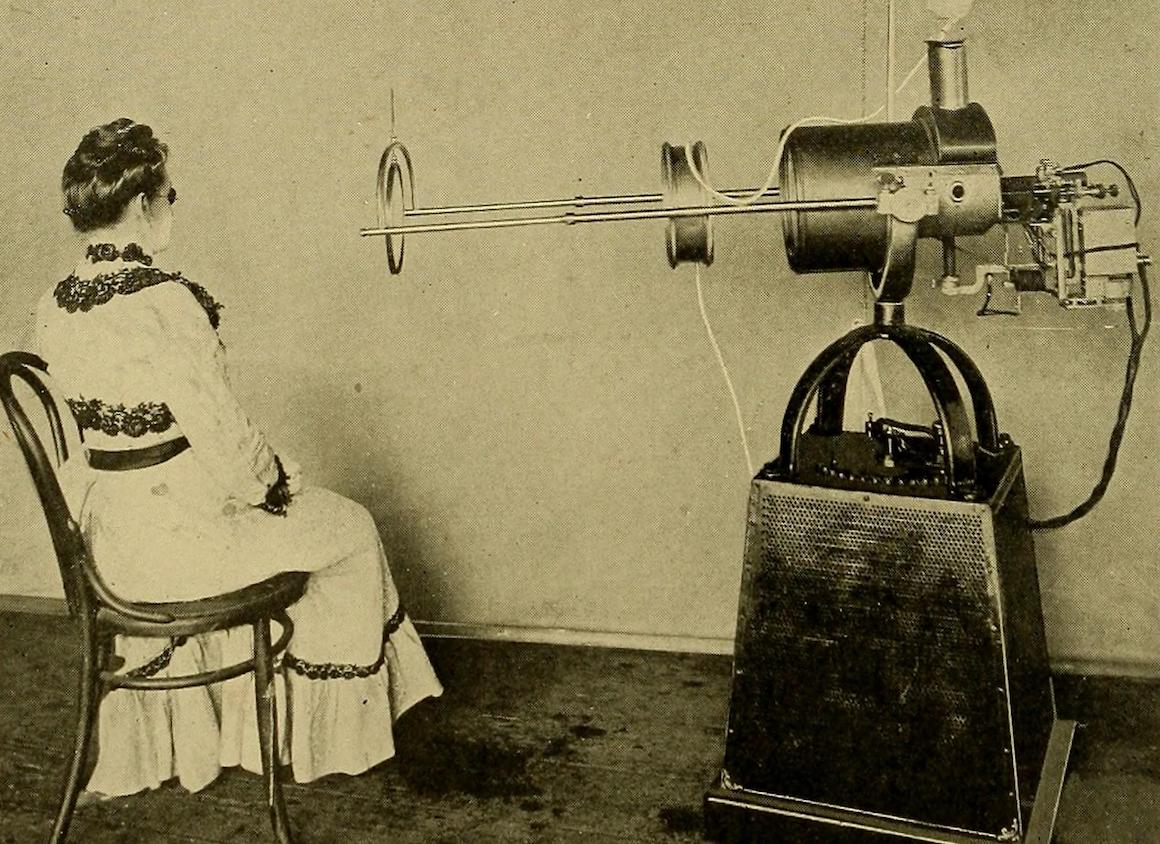 Vintage photograph of a woman and an X-ray machine
