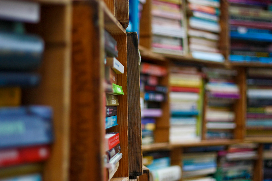 photo of a wooden bookshelf filled with books
