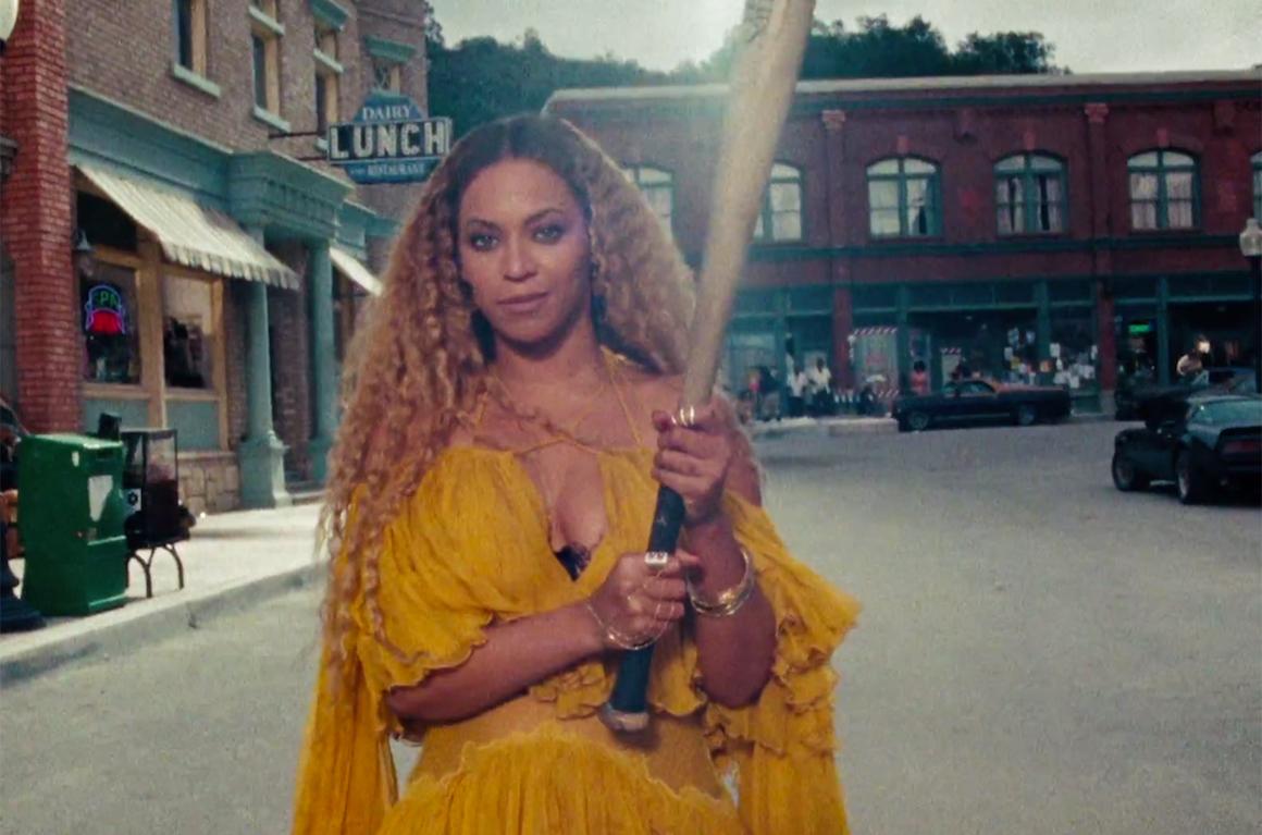Beyonce holding a baseball bat