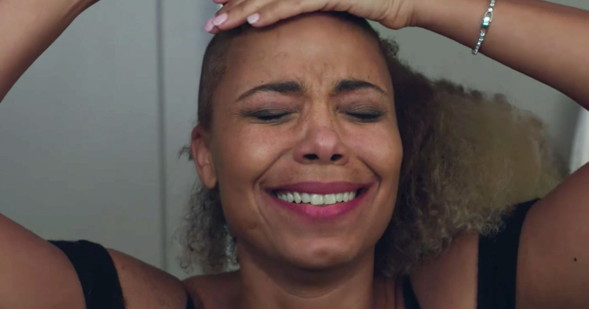 Still from 'Nappily Ever After' of a woman shaving her head and crying
