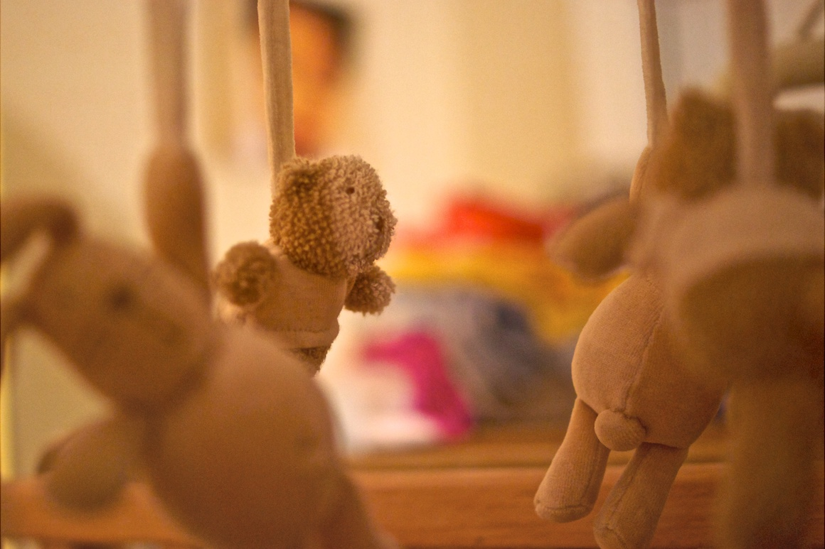 a child's mobile of stuffed bears