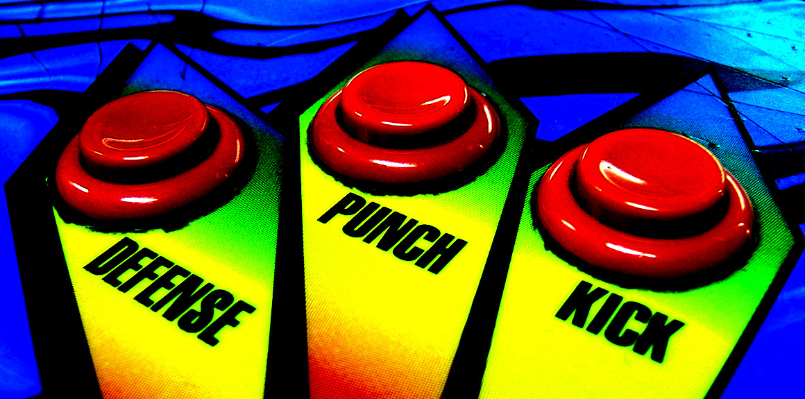 "buttons on an arcade game labeled ""defense,"" ""punch"" and ""Kick"""